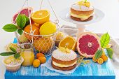 stock photo of sponge-cake  - Citrus Victoria Sponge Cake with Lemon Curd and variety of fresh citrus fruits - JPG