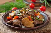 foto of liver fry  - Roast chicken liver with vegetables on wooden background - JPG