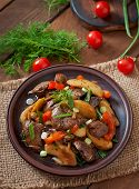 picture of liver fry  - Roast chicken liver with vegetables on wooden background - JPG