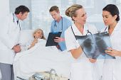 foto of x-files  - Doctors discussing about patients file in hospital room - JPG