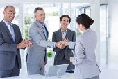 foto of interview  - Interview panel shaking hands with applicant in the office - JPG