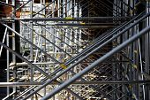image of scaffold  - Industrial shot with scaffolding and no people on a construction site - JPG