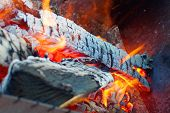picture of brazier  - brightly burning wood in a metal brazier - JPG