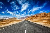foto of jammu kashmir  - Road in mountains Himalayas and dramatic clouds on blue sky - JPG