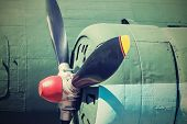 picture of propeller plane  - the big propeller on the motor of the old plane closeup and a side view in retro tones - JPG