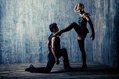 stock photo of tango  - Two beautiful dancers perform the tango - JPG