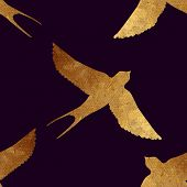 stock photo of swallow  - Creative design with golden silhouette of a swallow - JPG