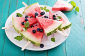 picture of popsicle  - Fresh watermelon popsicles with blueberries cut on ice - JPG
