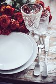 stock photo of wedding table decor  - Vintage table setting with glasses and cutlery on an old wooden board - JPG