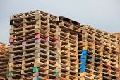 image of wooden pallet  - Stacked wooden pallets at a pallet storage - JPG