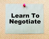 stock photo of negotiating  - Learn To Negotiate written on paper note pinned with red thumbtack on wooden board - JPG