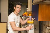picture of mixer  - Young man preparing healthy smoothie drink in mixer - JPG