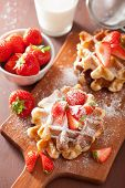 stock photo of icing  - belgian waffles with icing sugar and strawberry - JPG