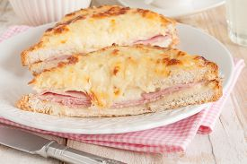 picture of french toast  - Croque Monsieur a traditional French toasted cheese and ham sandwich topped with bechamel sauce - JPG