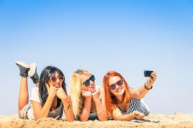 stock photo of  friends forever  - Group of girlfriends taking a selfie at the beach  - JPG