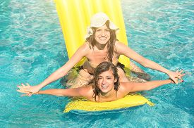 picture of  friends forever  - Best friends in bikini enjoying time together outdoors in swimming pool  - JPG