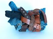 foto of vaquero  - shot of three pair of jeans tied with three belts - JPG