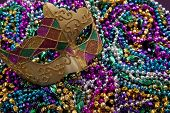 image of mardi-gras  - A group of Mardi Gras beads an mask with copy space - JPG