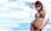 pic of bikini model  - Sexy bikini model over sea background - JPG