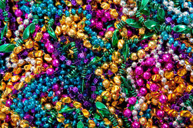 picture of mardi-gras  - A background of colorful mardi gras beads including gold - JPG