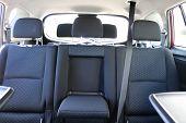 Car Interior. Rear Seats Of A Car Interior. Auto Interior With Back Seats, Sunlight Flaring Through. poster