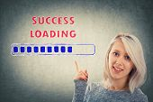 Businesswoman, With A Happy Emotion, Showing With Her Hand To A Loading Bar Symbolizing Business Suc poster