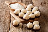 Authentic Brazilian Sweets Beijinhos With Condensed Milk And Coconut Close-up. Horizontal poster