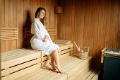 Beautiful Woman Resting In Sauna And Sweating poster