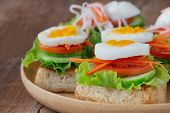 Open Faced Sandwich With Toast Lettuce Tomato Carrot Cucumber And Boil Egg. Grilled Sandwich On Wood poster