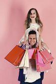 Schoolgirl And Father Do Shopping And Have Fun. Shopping, Presents And Family Concept. Daughter Sits poster