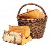 Basket of cut logs fire wood from Silver Birch tree (Betula pendula). Renewable resource of a energy