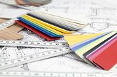 color samples of architectural materials - plastics, metric folding ruler and architectural drawings