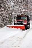 stock photo of plowing  - Plowing the snow on a rural road - JPG