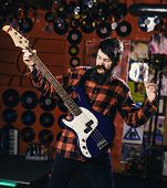 Musician With Beard Play Electric Guitar. Musician, Frontman, Soloist, Singer Play Guitar In Music C poster