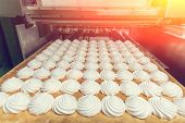 Zephyr Or  Marshmallows On Tray In Production Line Machine. Cookie Production, Toned With Light Effe poster