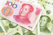 A Close Up Image Of A Red, One Hundred Chinese Yuan Bank Note, Close Up On A Background Of Green One poster