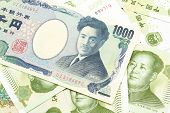 A One Thousand Japanese Yen Bank Note Close Up In Macro With Chinese One Yuan Bills poster