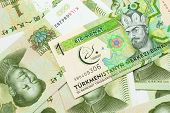 A One Manat Bank Note From Turkmenistan Close Up In Macro With An Assortment Of Chinese One Yuan Ban poster