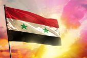 Fluttering Syrian Arab Republic Flag On Beautiful Colorful Sunset Or Sunrise Background. Syrian Arab poster