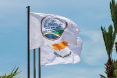 The Flag Of Agia Napa Municipality And The Flag Of Cyprus. Flags On The Flagpole And The Stereet Lam poster