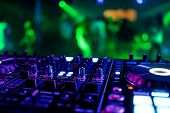 Dj Mixer Controller At A Party In A Nightclub poster