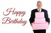 Happy Birthday. A handsome man in a suit holds a pink and white spotted gift box. Birthday Day gift  poster