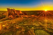 Sunbeams Light And Sunset Colors Sky Over Giant Granite Boulders At Karlu Karlu Or Devils Marbles In poster