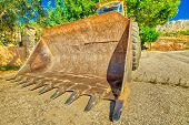 Wide Angle And Bottom View Of Yellow Bulldozer Excavator On Wheels For Building Work On A Road. Work poster