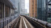 Japan Rapid Train On The Rail Track With Modern Building In The City, Transportation In Tokyo City,  poster