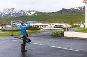 Photographer take photo in Grundarfjordur city near famous Kirkjufell waterfall, Iceland, Europe poster