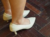 Close Up Of Woman Legs In High Heel Shoes On Parquet. poster