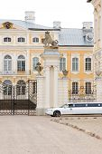 stock photo of luxury cars  - Wedding car waiting in front of palace for the newly married couple - JPG