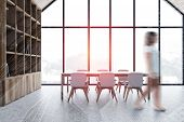 Blurry Young Woman Walking In Attic Dining Room With Panoramic Window, Concrete Floor, Long Dining T poster