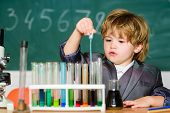 Education Concept. Experimenting With Chemistry. Talented Scientist. Boy Test Tubes Liquids Chemistr poster